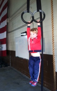 Julian trying to do a ring pull up like his Mama. See being healthy and being active starts NOW! Teach your kids a healthy lifestyle is the NORM!