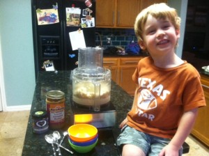 Julian showing off his healthy Paleo ingredients for his favorite version of banana ice cream