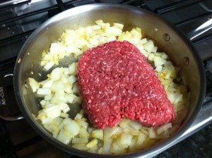 Adding the ground beef and pork sausage
