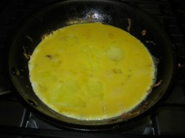 Scrambling Eggs after the pork and vegetables were removed from the pan
