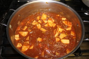 The Paleo Bison and Acorn Squash Chili is ready to simmer after adding the acorn squash and crushed tomatos