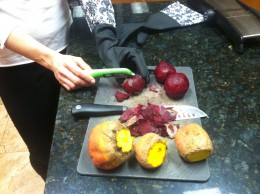 Using kitchen gloves and my oldest cutting board to peel the beets to avoid staining