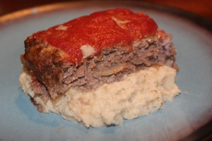 Close up of my delicious and juicy paleo meatloaf served with roasted cauliflower onion and garlic mashers