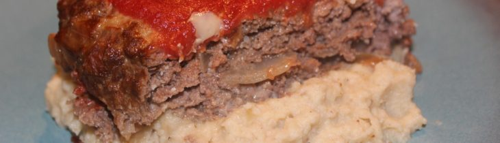 Close up of my delicious and juicy Paleo Meatloaf served with my Roasted Paleo Garlic, onion, and Cauliflower Mashers. Can this be heaven too?