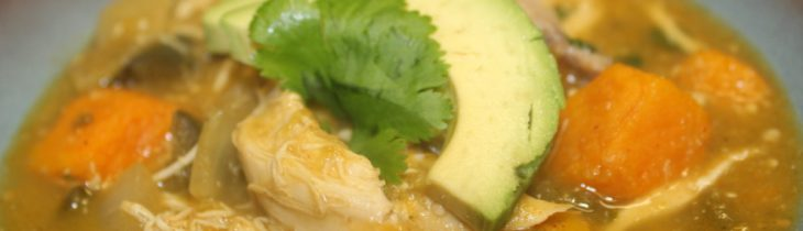 Close up of the finished product my Paleo Chicken and Butternut Squash Chili Verde with Fresh Tomatillos topped with fresh avocado and cilantro