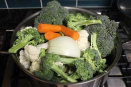 Added all the chopped vegetables and the 7 cups of chicken broth. Waiting now for my fresh vegetables to come to a boil for my Paleo Broccoli Vegetable Soup