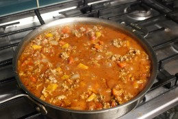 Adding the spices and crushed tomato sauce to my Homemade Paleo Ground Beef and Pork Tomato Meat Sauce Version 2