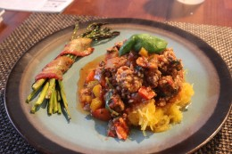 Close up of my Homemade Paleo Ground Beef and Pork Tomato Meat Sauce Version 2.0 served over roasted spaghetti squash and roasted bacon wrapped asparagus. This is what I call dinner!