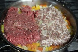 Getting ready to brown my ground meat and pork once the onions and veggies are translucent. Love showing the contrast in the meats before they get mixed together