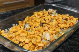 Third step is to place the roasted sweet potatoes for my Paleo Pork Sausage Veggie and Egg Breakfast Casserole