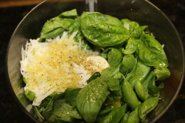Added olive oil, salt and pepper to the basil and cheese and hit blend.