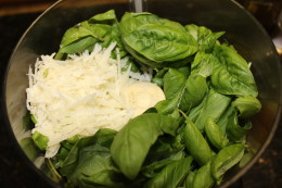 While your zoodles are cooking, it is now time to make the pesto. How beautiful is the contrast of colors in the parmigiano reggiano cheese and fresh basil?