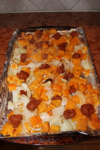 Crumbling the chorizo on top of your roasted vegetables and then bake for another 10 minutes