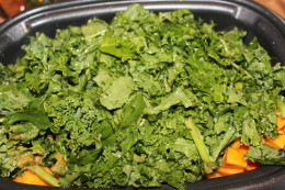 Finally, fill the crock pot with as much kale as you can and top of with yummy broth
