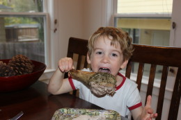 "Julian says, ""Look Mama, i can use one hand and this turkey leg is the size of my head."" Boys will be boys"