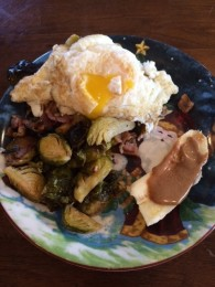 A fried egg over easy served over leftovers of my Paleo Roasted Brussel Sprouts. This hash was just as amazing as the night before!