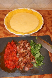 First step is to place your scrambled eggs, coconut milk and spices and pour it on top of your spaghetti squash crust