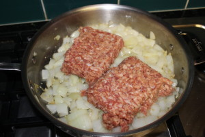 Once the onions are cooked to your liking (think low and slow), then add the pork sausage and brown.