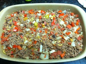 Adding the paleo picadillo to baking dish pan