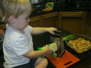 Chef in training grating the cheese