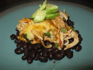 Chicken enchilada over black beans with fresh Avocado