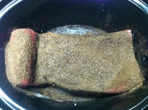 Place the coffee and chocolate dry rubbed brisket in the crock pot over the clear and liquid portion of the coconut milk