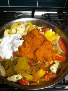 Pumpkin Chicken Curry Stir Fry adding pumpkin, coconut milk and spices