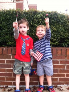Victory lap picture with new haircuts and their prize for sitting still: lollipops!